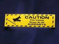 CAUTION THIS VEHICLE STOPS AT ALL AIRPORTS Bumper Sticker
